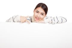 Asian girl with scarf point down , rest her chin on  blank sign Stock Image
