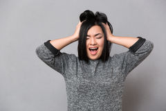 Asian girl screaming with closed eyes Stock Photos