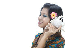 Asian girl with sea shell Royalty Free Stock Photos