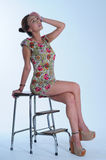 Asian girl seating. With flora dress royalty free stock image