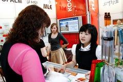 Asian girl sells cosmetics Stock Photography