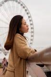 Asian Girl sending kisses. On Pier of Hong Kong Island Stock Image