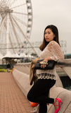 Asian Girl sending kisses. On Pier of Hong Kong Island Stock Photography