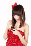 Asian girl sending sms. Stock Photography