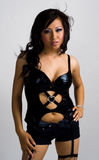 Asian girl in sexy black leather outfit Stock Image