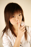 Asian girl shhh Stock Photography