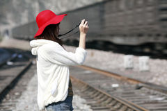Asian girl shooting train Royalty Free Stock Image