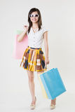 Asian girl with shopping bags Stock Images