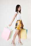 Asian girl with shopping bags Stock Photo