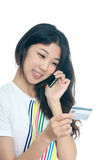 Asian girl shopping with credit card Royalty Free Stock Photos