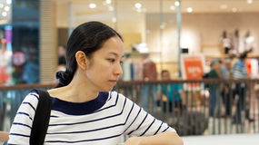 Asian girl in shopping mall background Royalty Free Stock Image