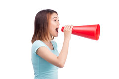 Asian girl shouting with a megaphone Royalty Free Stock Photography