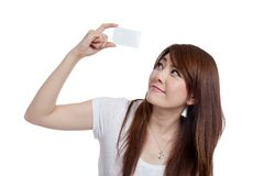 Asian girl show a card over head look up and smile. Isolated on white background Royalty Free Stock Images