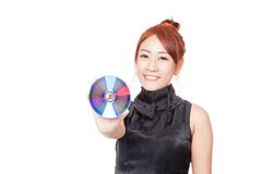 Asian girl show a disc and smile Stock Photos