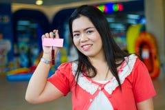 Asian girl show mark wood Stock Photos
