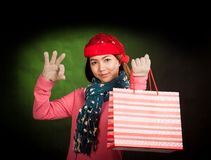 Asian girl show OK  with christmas hat and shopping bag Stock Photos
