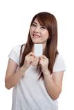Asian girl show a vertical  blank card and smile Stock Image
