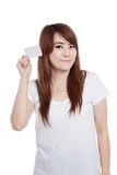 Asian girl show a white card and smile Stock Photo