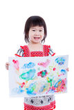 Asian girl showing her artwork, studio shot,  isolated on white Royalty Free Stock Photo