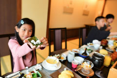 Asian girl showing homemade sushi by herself Royalty Free Stock Photos
