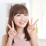 Asian girl showing v hands sign Royalty Free Stock Photos