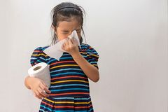 Asian girl sick with sneezing on nose and cold cough on tissue paper.  royalty free stock images