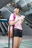 Asian girl at singapore's changi airport terminal Stock Image