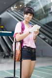 Asian girl at singapore's changi airport terminal Royalty Free Stock Photography