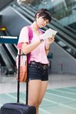 Asian girl at singapore's changi airport terminal Stock Photography