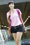 Asian girl at singapore's changi airport terminal Royalty Free Stock Image