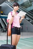 Asian girl at singapore's changi airport terminal Royalty Free Stock Photos