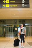 Asian girl at singapore's changi airport terminal Stock Image