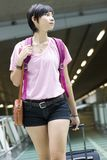 Asian girl at singapore's changi airport terminal Stock Images