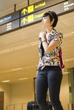 Asian girl at singapore's changi airport terminal Stock Images
