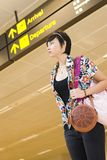 Asian girl at singapore's changi airport terminal Royalty Free Stock Photo