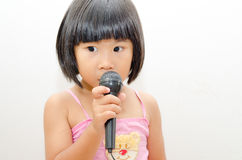 Asian girl singing Royalty Free Stock Photography