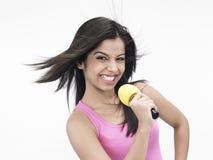 Asian girl singing Stock Photo