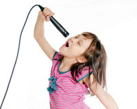 Asian girl singing with microphone stock photo