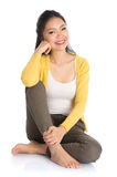 Asian girl sitting on floor Stock Images