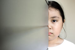 Asian girl sitting on floor at home. Bullying and isolation conc Royalty Free Stock Images