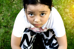 Asian girl sitting on floor at home. Bullying and isolation conc Royalty Free Stock Image
