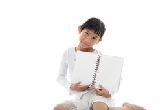 Asian girl sitting and holding blank notebook. On white background Stock Photo
