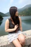 Asian girl sitting outdoors Stock Photos