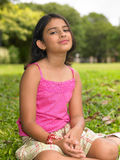 Asian girl sitting in the park Royalty Free Stock Photos
