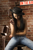 Asian girl sitting and smoking Royalty Free Stock Photography