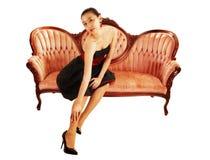 Asian girl sitting on sofa. Stock Image