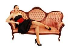 Asian girl sitting on sofa. Royalty Free Stock Photos