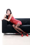 Asian girl sitting on sofa. Stock Photography
