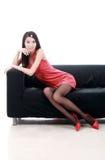 Asian girl sitting on sofa. stock photography