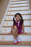 Asian girl sitting on steps Royalty Free Stock Photography